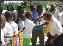 Mofat Fugui, Minister of Environment and Danny Philip, local member, are welcomed by Kolombangarans